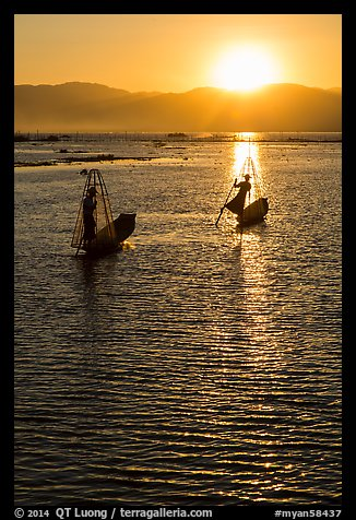 Intha fishermen with setting sun. Inle Lake, Myanmar (color)