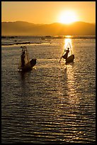 Intha fishermen with setting sun. Inle Lake, Myanmar ( color)