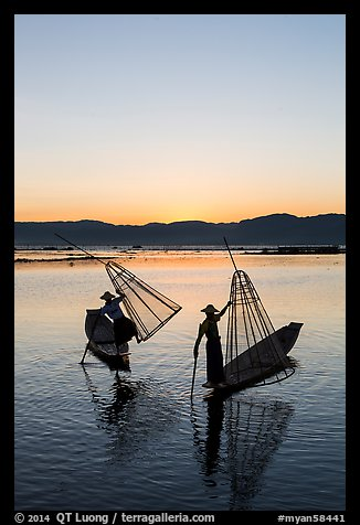 Intha fishermen lifting conical basket net at sunset. Inle Lake, Myanmar (color)