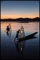 Intha fishermen carrying lanterns at dusk. Inle Lake, Myanmar ( color)