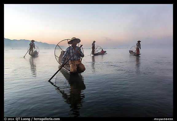 Group of Intha fishermen at dawn with surface mist. Inle Lake, Myanmar (color)