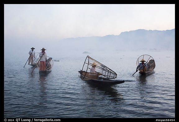 Group of Intha fishermen on misty waters. Inle Lake, Myanmar (color)