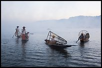 Group of Intha fishermen on misty waters. Inle Lake, Myanmar ( color)