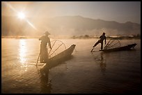 Sun piercing mist behind Intha fishermen. Inle Lake, Myanmar ( color)