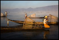 Intha fishermen with conical baskets in morning mist. Inle Lake, Myanmar ( color)