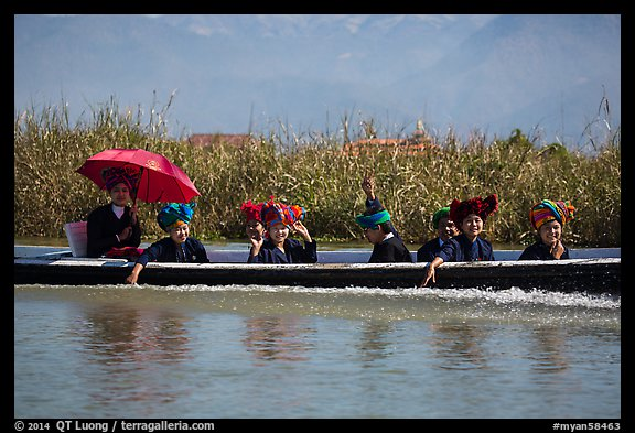 Women with turbans on long tail boat. Inle Lake, Myanmar (color)