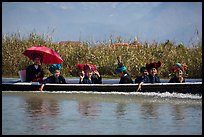 Women with turbans on long tail boat. Inle Lake, Myanmar ( color)