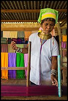 Padaung (long neck) woman threading yarn. Inle Lake, Myanmar ( color)
