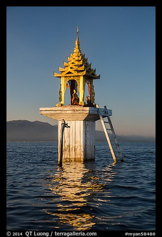 Water level marker topped by shrine. Inle Lake, Myanmar (color)
