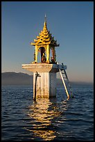 Water level marker topped by shrine. Inle Lake, Myanmar ( color)