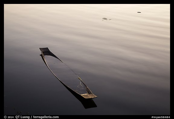 Sunken canoe and ripples. Inle Lake, Myanmar (color)