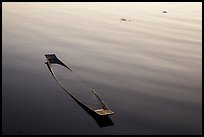 Sunken canoe and ripples. Inle Lake, Myanmar ( color)