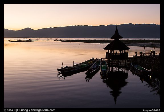 Deck, pavillion, and longtail boats at sunset. Inle Lake, Myanmar (color)