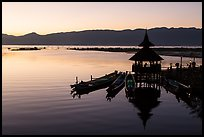 Deck, pavillion, and longtail boats at sunset. Inle Lake, Myanmar ( color)