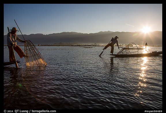 Intha fishermen and sun. Inle Lake, Myanmar (color)