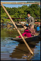 Couple leaving market on their boat. Inle Lake, Myanmar ( color)
