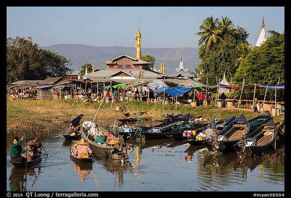 Villagers arriving by boat at market. Inle Lake, Myanmar (color)