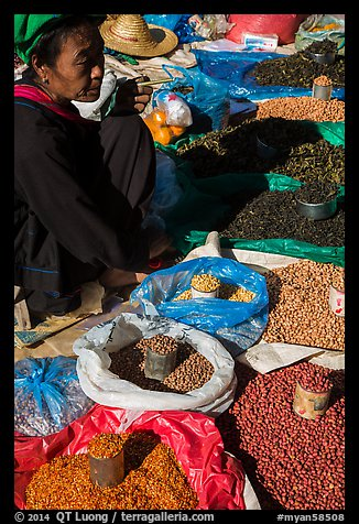 Market vendor with cheerot cigar. Inle Lake, Myanmar (color)