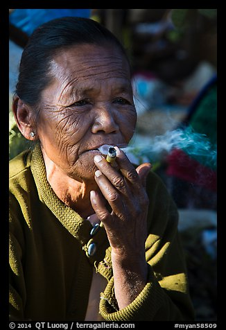 Woman smoking cheerot cigar. Inle Lake, Myanmar (color)