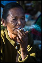 Woman smoking cheerot cigar. Inle Lake, Myanmar ( color)