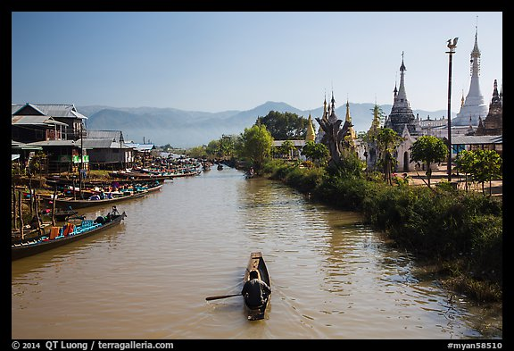 Boats and stupas bordering Ywama Village canal. Inle Lake, Myanmar (color)