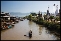 Boats and stupas bordering Ywama Village canal. Inle Lake, Myanmar ( color)