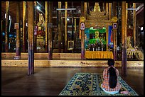 Woman praying at Nga Phe Kyaung monastery. Inle Lake, Myanmar ( color)