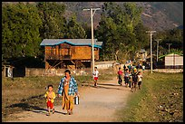 Villagers walking on path to jetty, Maing Thauk Village. Inle Lake, Myanmar ( color)