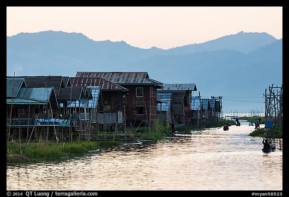 Houses and canal at sunset, Maing Thauk Village. Inle Lake, Myanmar (color)