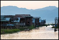 Houses and canal at sunset, Maing Thauk Village. Inle Lake, Myanmar ( color)