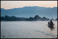 Boat leaving resort in dawn mist. Inle Lake, Myanmar ( color)