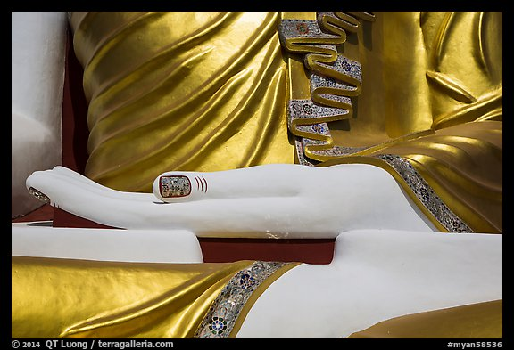 Detail of hand, of one of the four seated buddhas in  Kyaik Pun Paya. Bago, Myanmar (color)