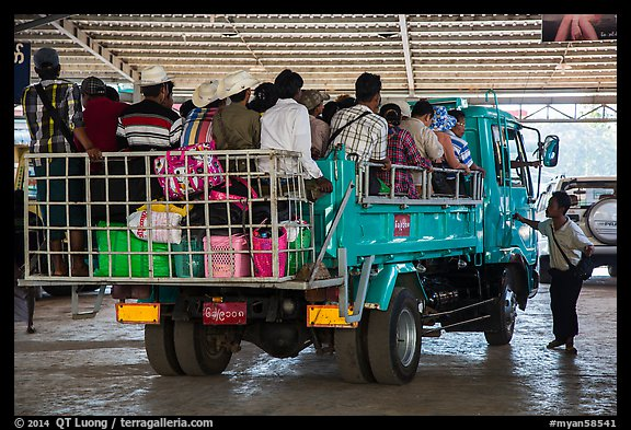 Bus leaving base station with 35 passengers in the back. Kyaiktiyo, Myanmar (color)