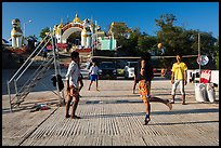 Young men play chin lone (kick volleyball) at Yatetaung. Kyaiktiyo, Myanmar ( color)