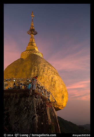 Monk standing on Golden Rock looks into the valley. Kyaiktiyo, Myanmar (color)