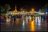 Crowds on main plaza at night. Kyaiktiyo, Myanmar ( color)