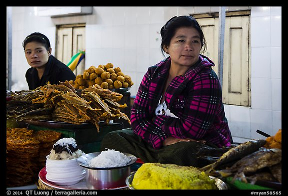 Women at street food stalls, Potemkin village. Kyaiktiyo, Myanmar (color)
