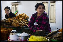 Women at street food stalls, Potemkin village. Kyaiktiyo, Myanmar ( color)