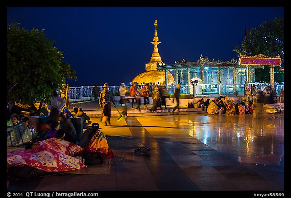 Pilgrims wake up after sleeping on plaza behind Golden Rock. Kyaiktiyo, Myanmar (color)