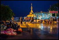 Pilgrims wake up after sleeping on plaza behind Golden Rock. Kyaiktiyo, Myanmar ( color)