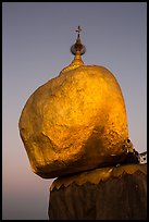 Golden rock gleaming at dawn. Kyaiktiyo, Myanmar ( color)