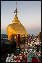 Pilgrim and food offerings behind Golden Rock at dawn. Kyaiktiyo, Myanmar ( color)