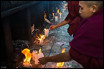 Monks lighting candles. Kyaiktiyo, Myanmar ( color)
