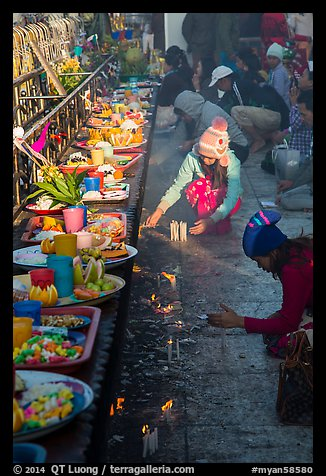 Morning food offering and pilgrims with cold weather hats. Kyaiktiyo, Myanmar (color)