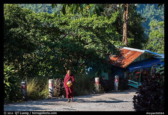 Monk walking barefoot on the path to the Golden Rock. Kyaiktiyo, Myanmar (color)