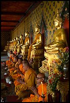 Buddhist monks and buddha statues, Wat Arun. Bangkok, Thailand (color)