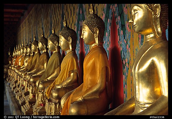 Row of Buddha figures, Wat Arun. Bangkok, Thailand (color)