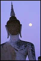 Moon and buddha image at dusk, Wat Mahathat. Sukothai, Thailand (color)