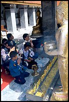 Worshipers at Wat Phra That Doi Suthep, the North most sacred temple. Chiang Mai, Thailand