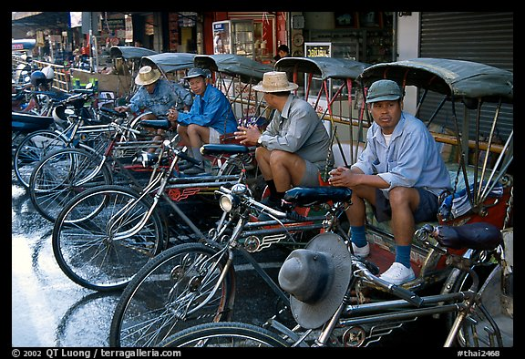 Tricycle drivers. Chiang Rai, Thailand (color)